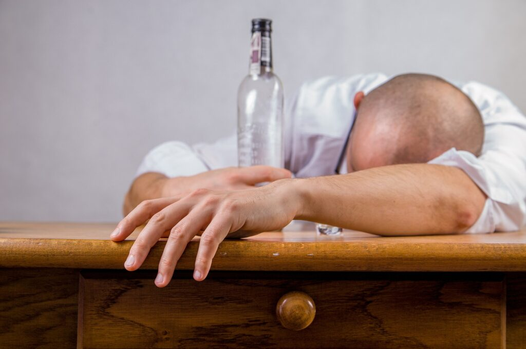 Alcohol consumption, such as what this man is doing, causes 85,000 deaths in the Americas.