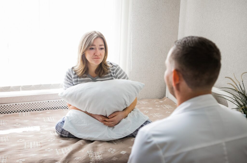Offering mental health help can be difficult but necessary, like here where a man talks to a woman.